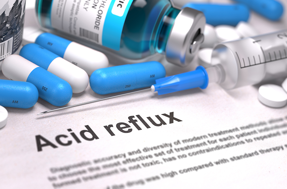 Diagnosis - Acid Reflux. Medical Concept with Blue Pills, Injections and Syringe. Selective Focus. Blurred Background.